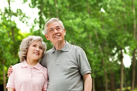 an elderly couple in the park