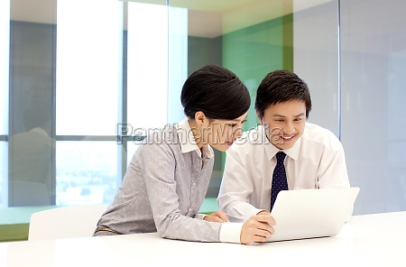 two business people communicate at work
