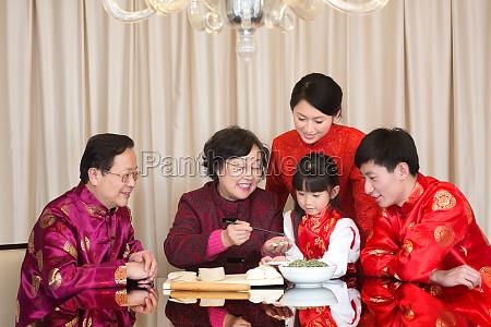 family eating dumplings
