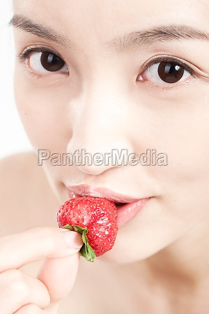 a woman with fruit beauty