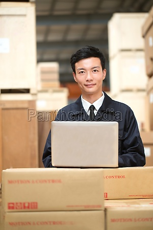 logistics personnel in the warehouse loading