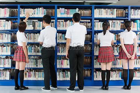 boy accompanying horizontal frame underage students