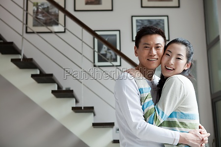 asians hugs adult woman happiness warm