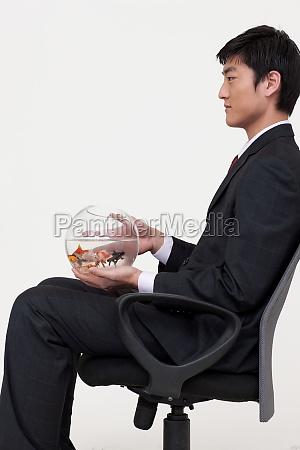 sitting oriental young men shed shot