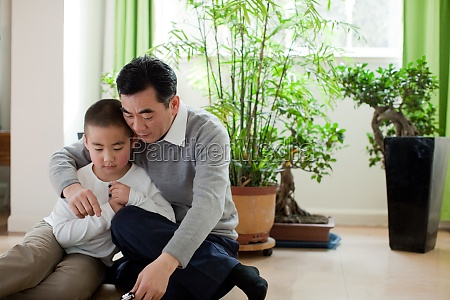 oriental figures older men communication family
