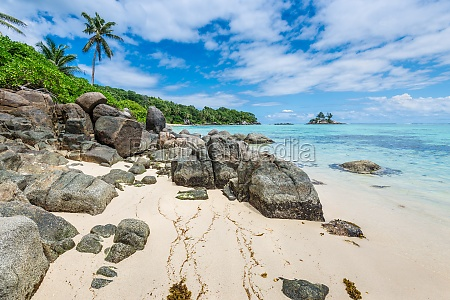 seychelles seascape with granite boulders in