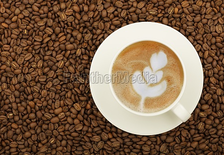 white cup of cappuccino over roasted