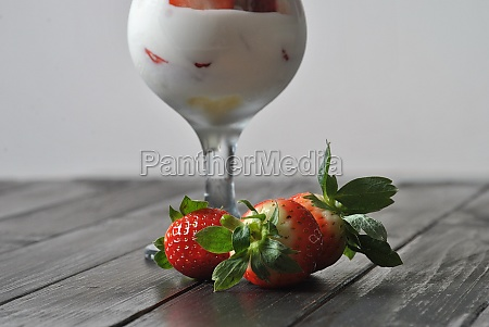 strawberries with ice cream in glass
