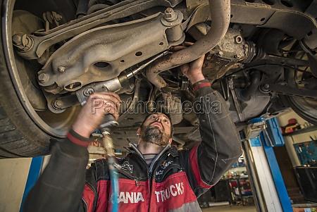 mechanic repairs the car 5