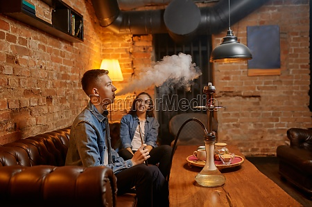love couple smokes at the table