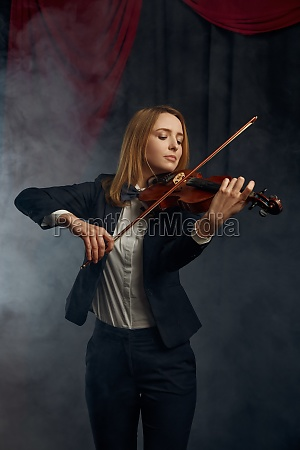 female violonist with violin performance on