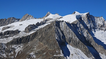 rugged mt geisshorn and glacier