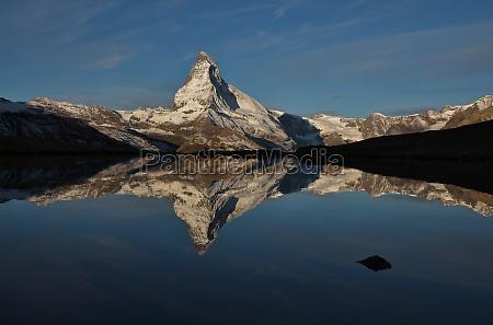 snow capped matterhorn mirroring in lake