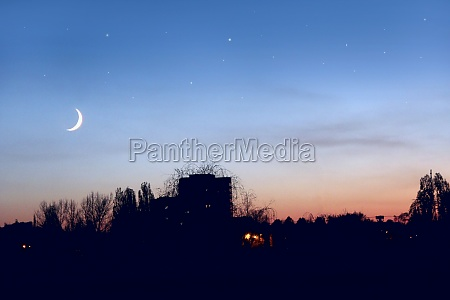 evening sky with stars and moon