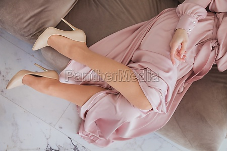 perfect female legs wearing high heels