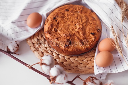 easter cake and eggs on wicker