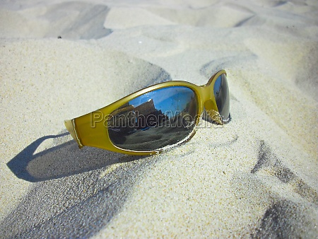 the sunglasses in the sand of