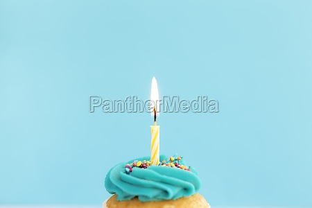 birthday greeting concept burning candle on