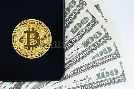 bitcoins coin and us banknotes