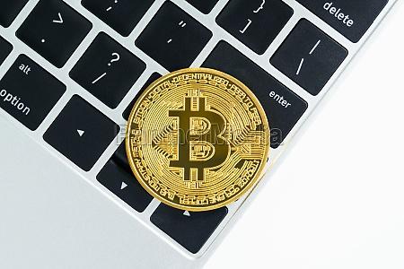 golden bitcoins coin on keyboard computer