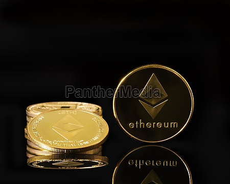 golden coins with ethereum symbol on