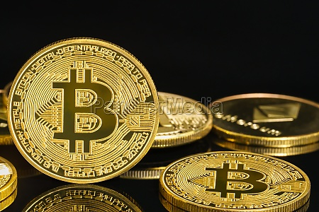 golden coins with bitcoin symbol on