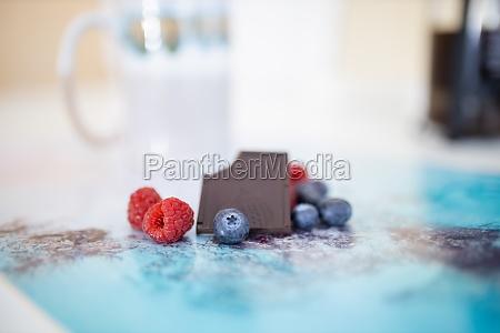 bitten chocolate bar and berries on