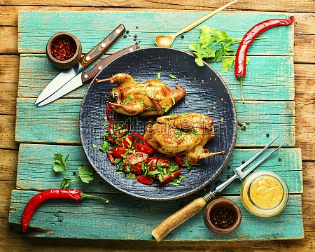 baked quail and vegetable salad on
