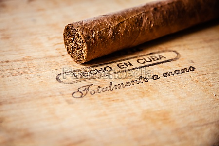 cuban cigar on vintage wooden box