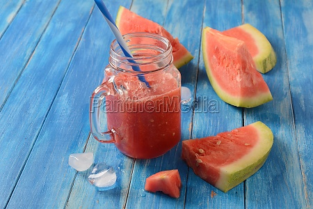 fresh watermelon cocktail in glass on