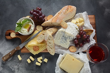 cheese platter with assorted cheeses grapes