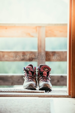 hiking boots inside of a rustic