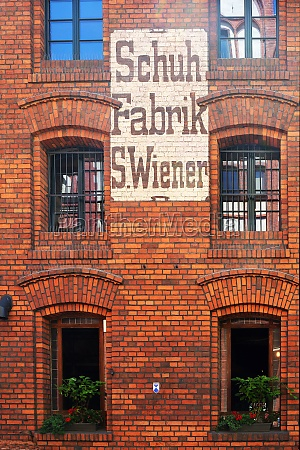 building with old lettering in torun