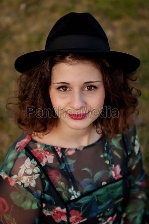 beautiful girl with flowered dress an