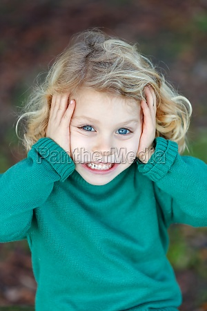 beautiful child in a park smiling
