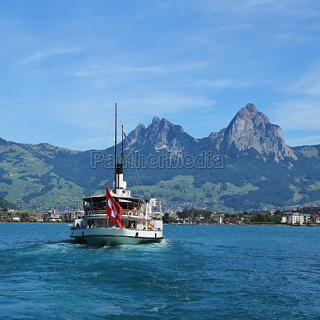 boat on lake vierwaldstattersee and mt