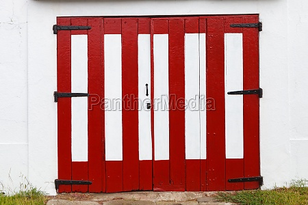 wooden wide door of a barn