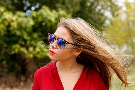 pretty blonde girl with sunglasses