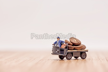 miniature truck with driver loaded with