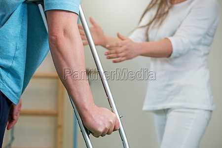 close up of man holding crutch