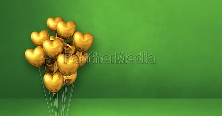 gold heart shape balloons bunch on