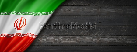 iranian flag on black wood wall