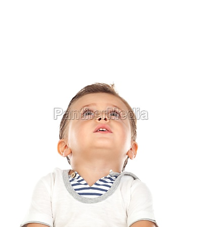 pensive baby looking up