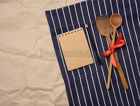 blue chefs apron wooden spoons and