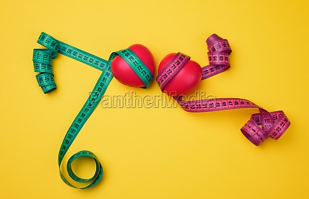red heart and green measuring tape