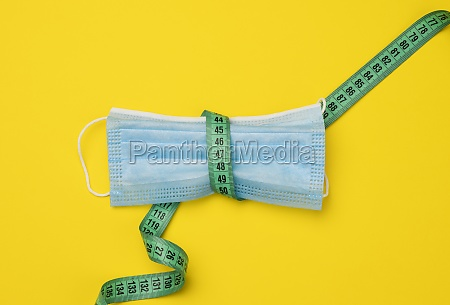 blue disposable medical mask on a