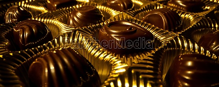 golden box with chocolate candies banner