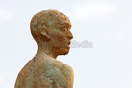 silhouette of a human statue of