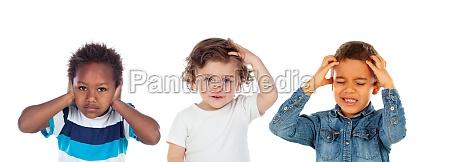 three worried children together