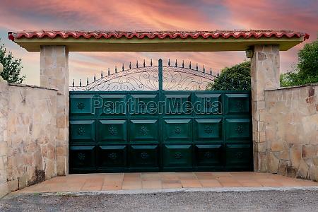 green metal gates